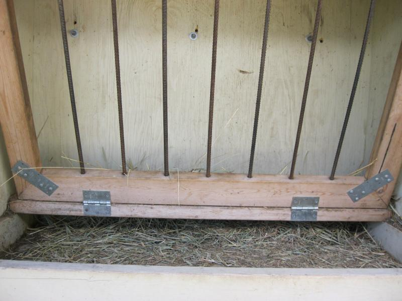 Hinged hay keeper